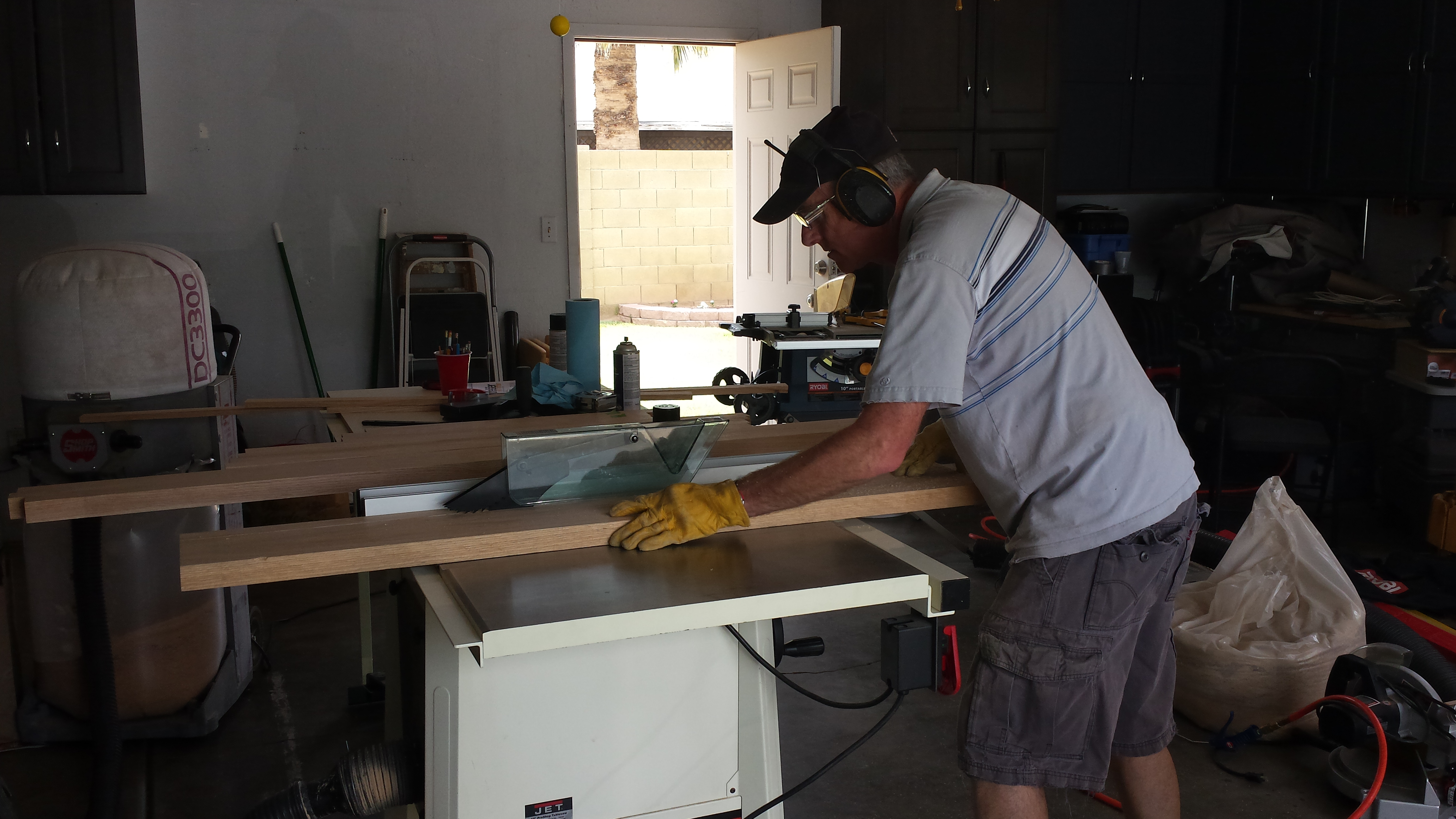 My dad cutting the legs for the dresser.